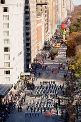 The Lafayette High School Mighty Lion Marching Band performs in the 92nd Macy's Thanksgiving Day Parade in New York City.