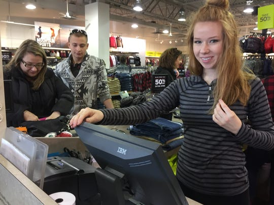 Mother and son Jennifer and Zachary Peitz shopped Eddie Bauer's outlet store at Tanger Outlets in Howell Township on Black Friday, Nov. 23, 2018. The line at sale associate Hannah Huff's register stayed constant all morning.