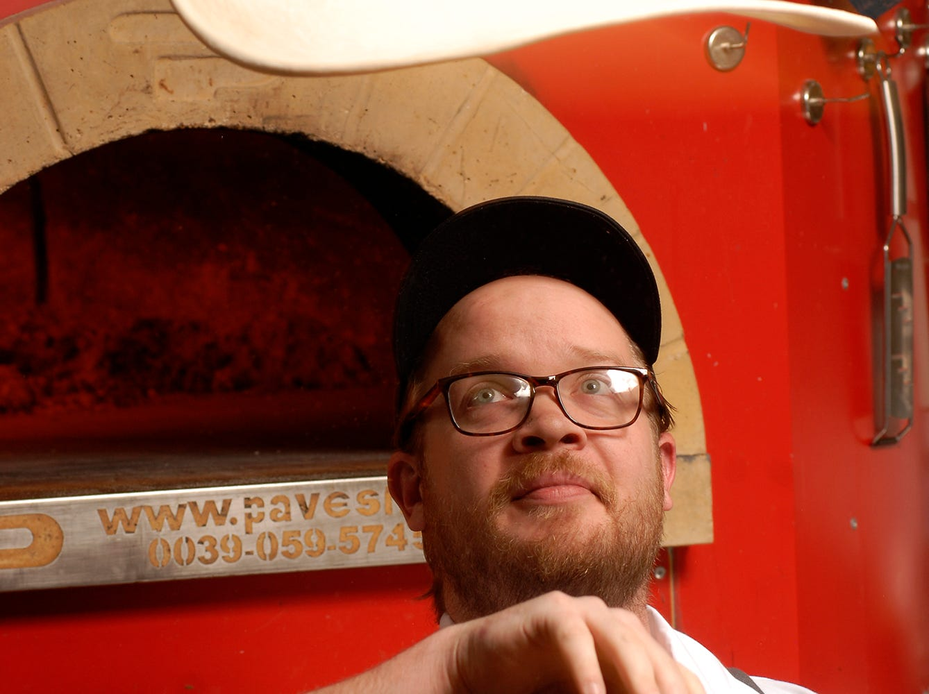 Chef Max Balliet tosses pizza dough while posing for a portrait.  He specializes in handmade pastas and wood-fired pizzas at Pizza Lupo located at 1540 Frankfort Ave.  Nov. 16, 2018