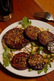 Roasted beets with Egyptian Dukkah at Pizza Lupo located at 1540 Frankfort Ave.  Nov. 16, 2018