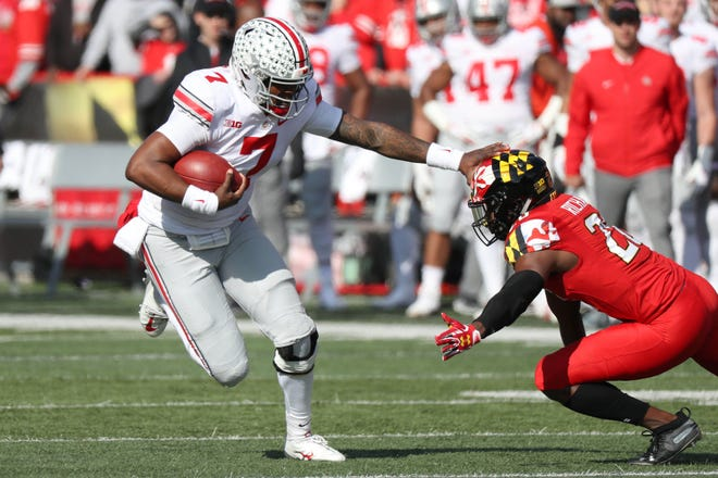 Ohio State quarterback Dwayne Haskins stiff-arms a defender during last Saturday's 52-51 overtime win at Maryland.