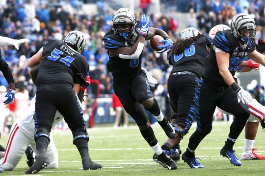 Memphis' Patrick Taylor Jr. runs up the middle against the Houston Cougars as the Tigers win the AAC West title 52-31 at the Liberty Bowl on Friday, Nov. 23, 2018.