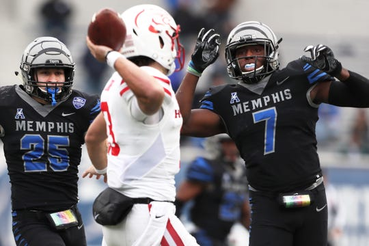 Memphis' Austin Hall, left, and Curtis Akins defend against Houston Cougars' Clayton Tuneas the Tigers win the AAC West title 52-31 at the Liberty Bowl on Friday, Nov. 23, 2018.