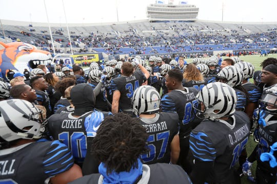 Memphis Tigers players huddle up before their game against the Houston Cougars at the Liberty Bowl on Friday, Nov. 23, 2018.