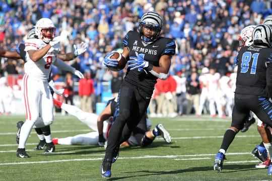 Memphis' Tony Pollard runs in for a touchdown against the Houston Cougars as the Tigers win the AAC West title 52-31 at the Liberty Bowl on Friday, Nov. 23, 2018.