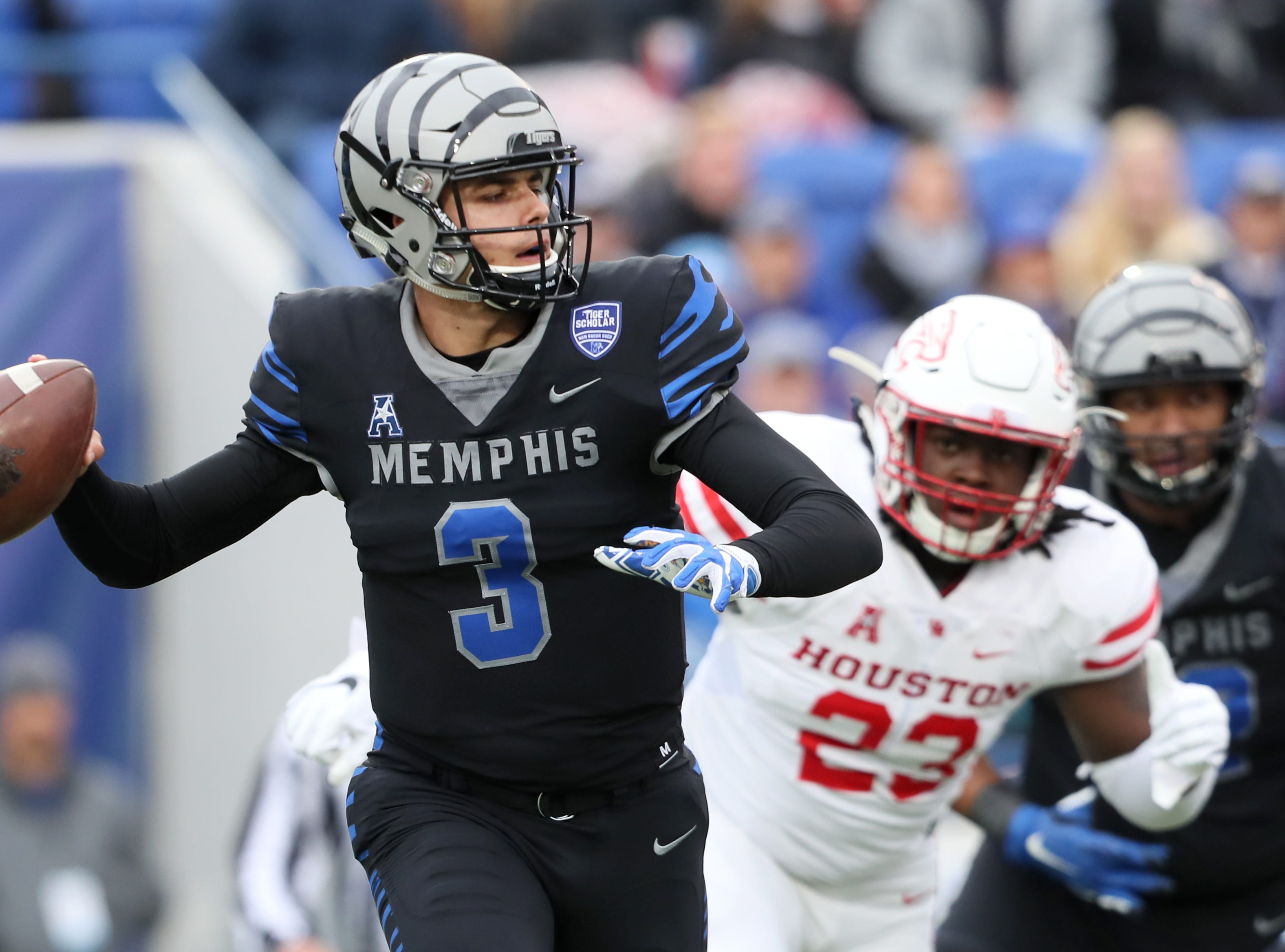 Memphis Tigers' Brady White looks to throw the ball against the Houston Cougars at the Liberty Bowl on Friday, Nov. 23, 2018.