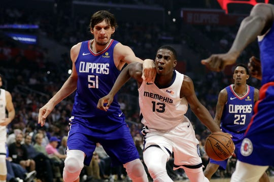 Memphis Grizzlies' Jaren Jackson Jr. (13) is defended by Los Angeles Clippers' Boban Marjanovic (51) during the first half of an NBA basketball game Friday, Nov. 23, 2018, in Los Angeles. (AP Photo/Marcio Jose Sanchez)