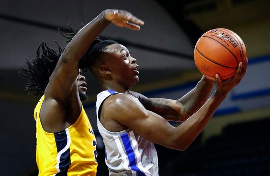 Memphis forward Kyvon Davenport (right) drives for a layup in front of Canisius defender Dantai St. Louis (left) during second day action in the Advocate Invitational in Orlando Friday, November 23, 2018.