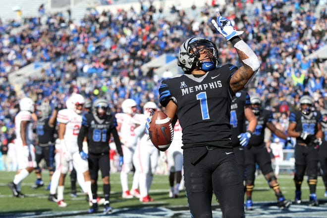 Memphis' Tony Pollard celebrates a touchdown against Houston as the Tigers won the AAC West title 52-31 on Nov. 23 at the Liberty Bowl.