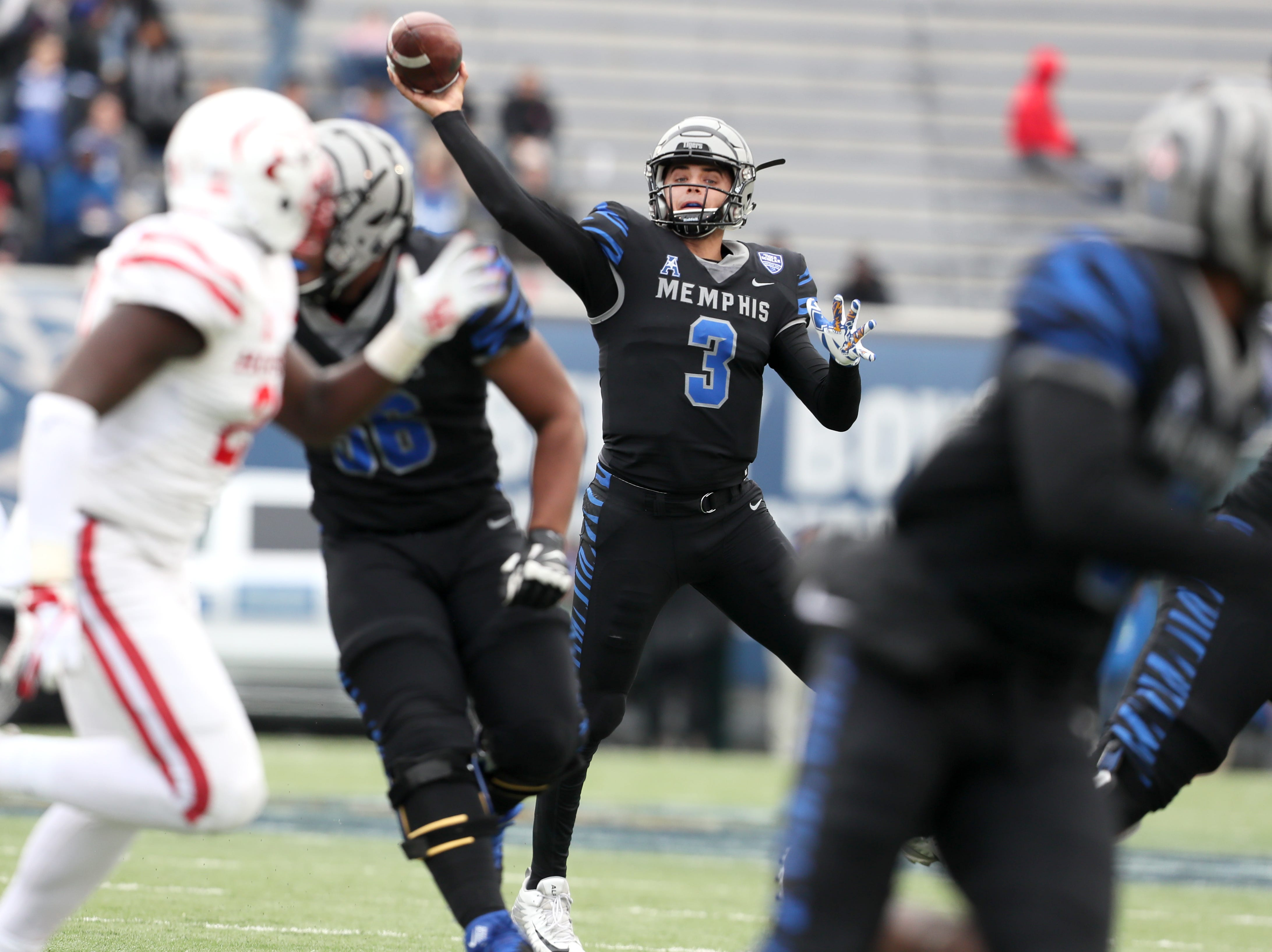 Memphis' Brady White throws the ball against Houston Cougars as the Tigers win the AAC West title 52-31 at the Liberty Bowl on Friday, Nov. 23, 2018.