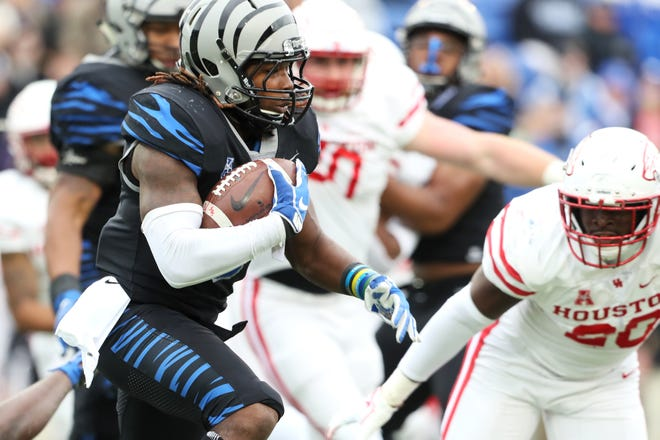 Memphis' Darrell Henderson runs the ball against the Houston Cougars as the Tigers win the AAC West title 52-31 at the Liberty Bowl on Nov. 23.