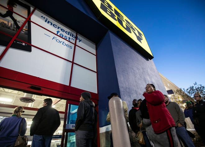 Customers wait in line at a Best Buy store for a Black Friday sale on Thanksgiving Day, in Memphis, Tenn. The electronics retailer will close its Winchester Road store on March 7, 2020.