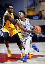 Memphis guard Tyler Harris (right) drives the lane against Canisius defender Dantai St. Louis (left) during second day action in the Advocate Invitational in Orlando Friday, November 23, 2018.