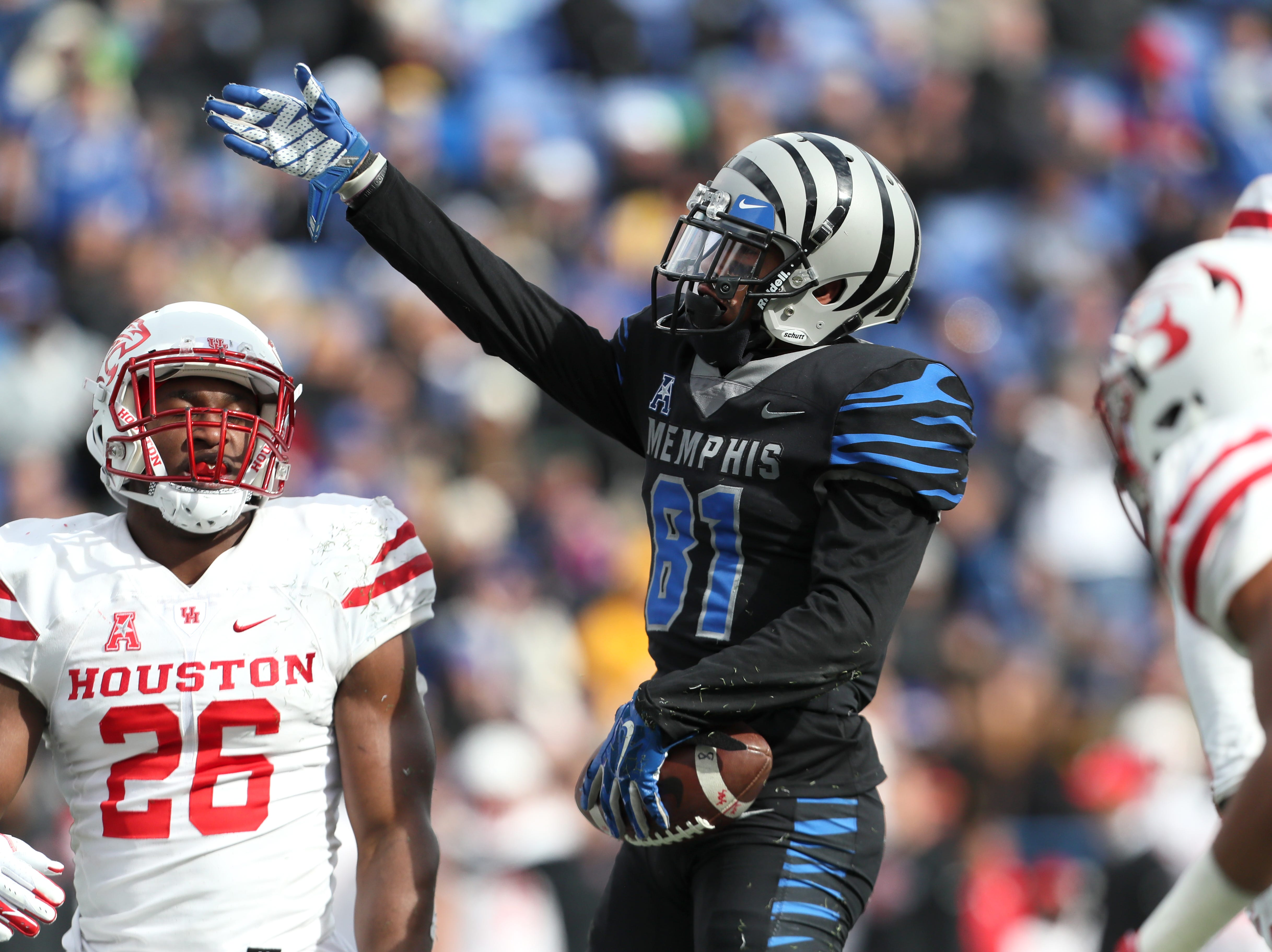 Memphis Tigers' Mechane Slade signals his own first down after a catch against the Houston Cougars at the Liberty Bowl on Friday, Nov. 23, 2018.
