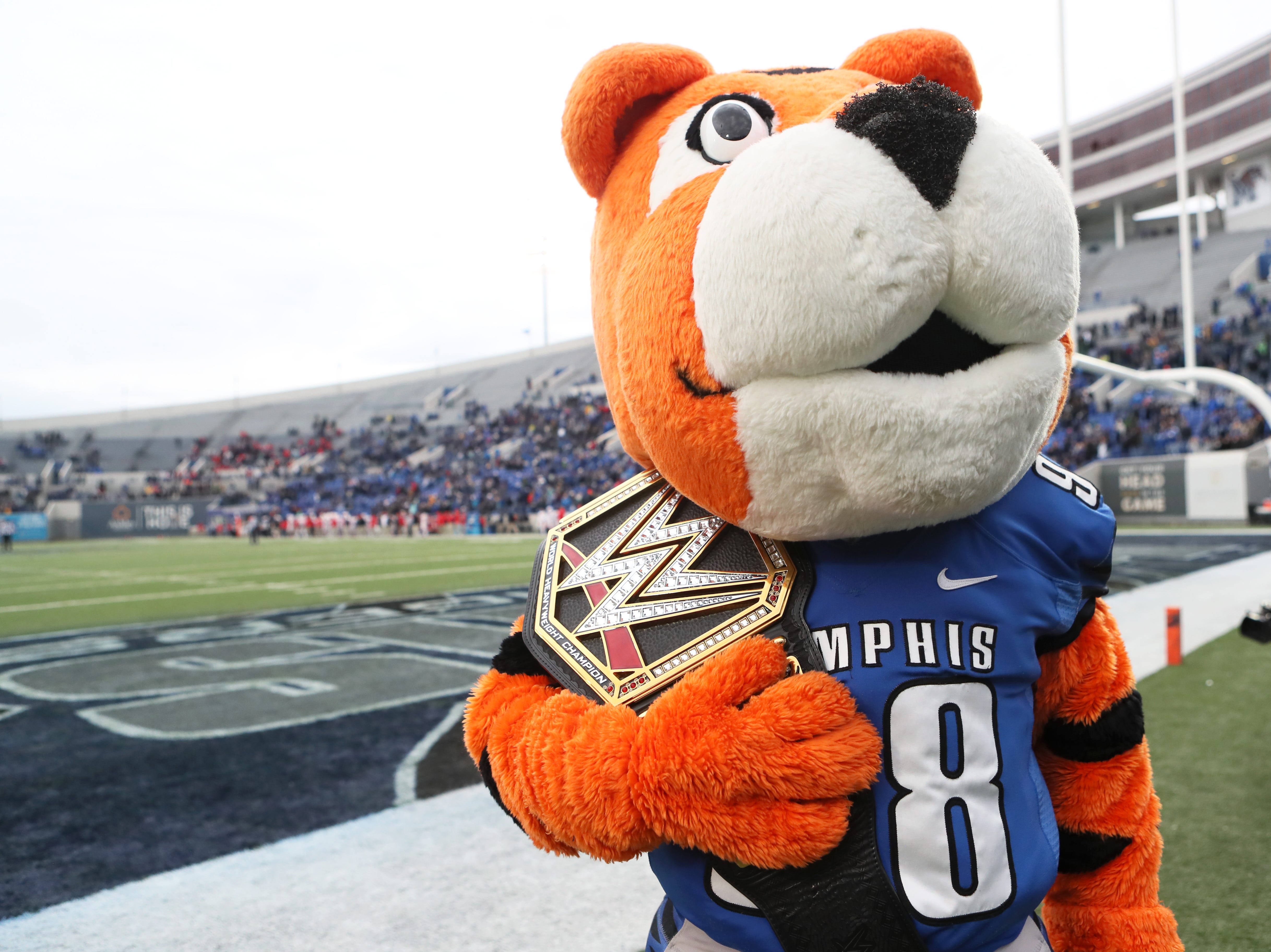 Pouncer holds the title belt as Memphis wins against the Houston Cougars taking the AAC West title 52-31 at the Liberty Bowl on Friday, Nov. 23, 2018.