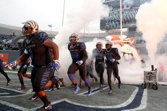 Memphis players run out on to the field against Houston Cougars as the Tigers win the AAC West title 52-31 at the Liberty Bowl on Friday, Nov. 23, 2018.