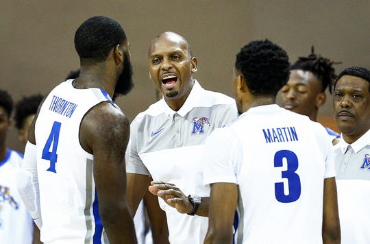 Memphis head coach Penny Hardaway (middle) during a timeout against Oklahoma State in the Advocate Invitational in Orlando Thursday, November 22, 2018.