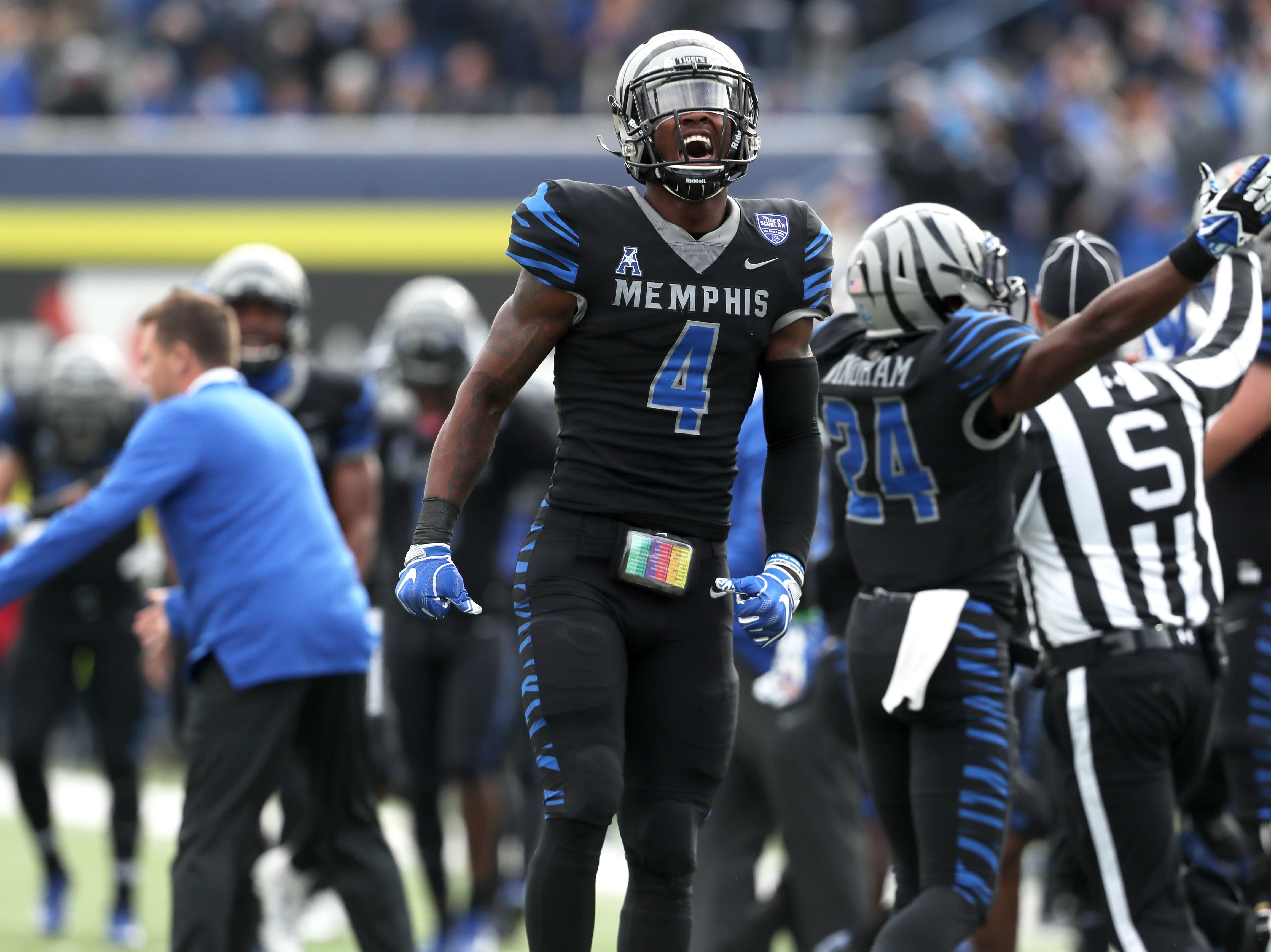 Memphis' Josh Perry celebrates on the sideline against Houston Cougars as the Tigers win the AAC West title 52-31 at the Liberty Bowl on Friday, Nov. 23, 2018.