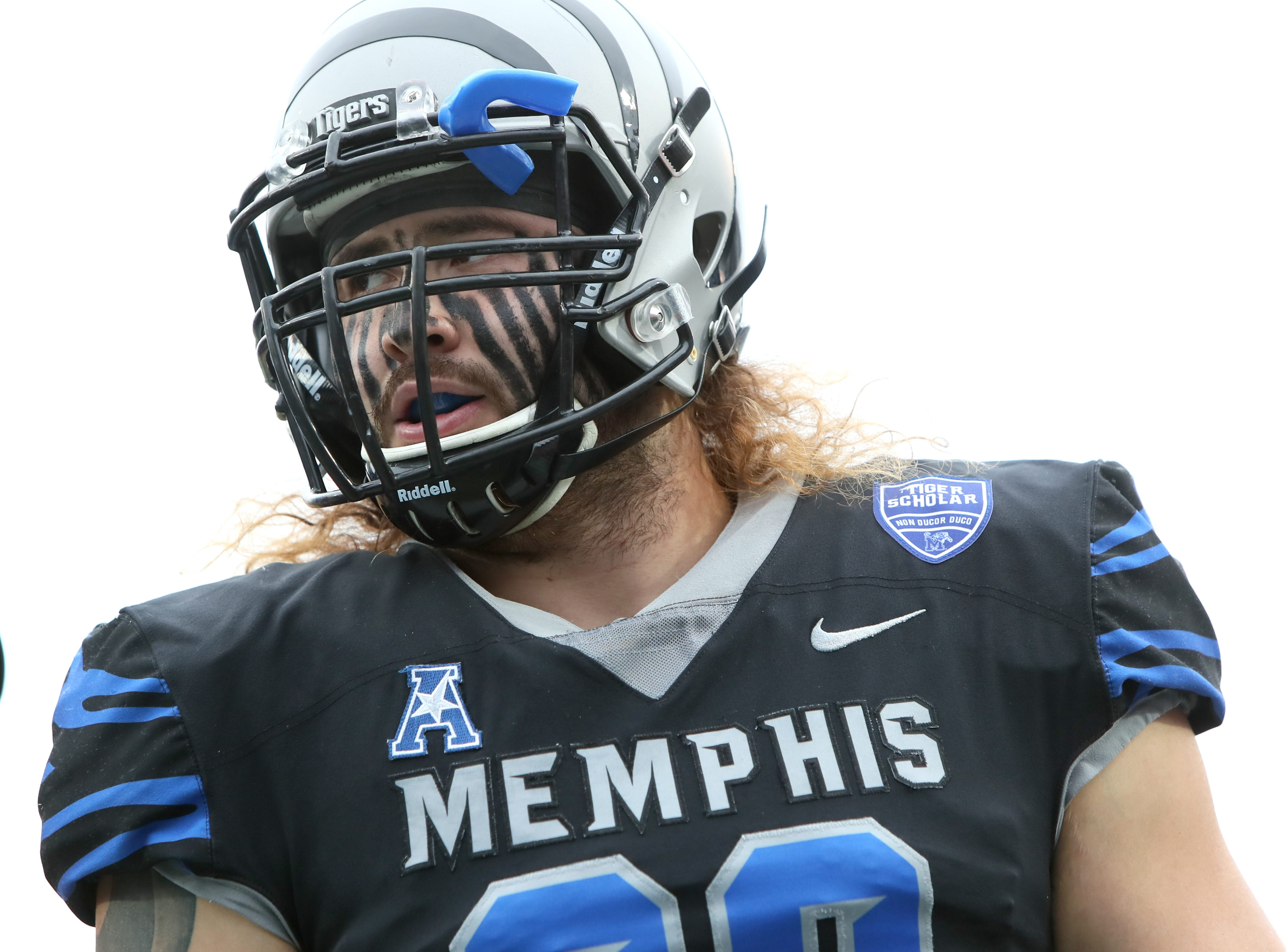 Memphis Tigers' Jonathan Wilson warms up before their game against the Houston Cougars at the Liberty Bowl on Friday, Nov. 23, 2018.