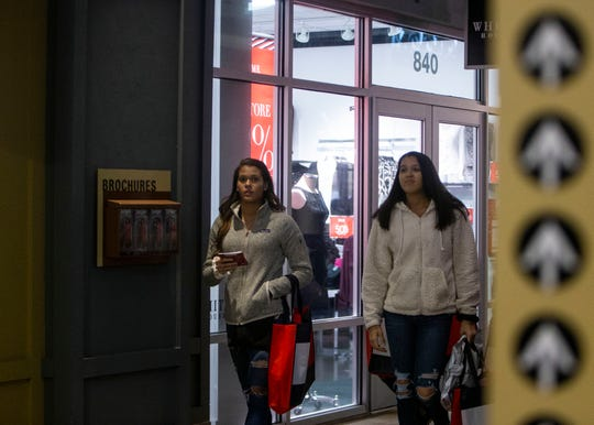 Tanger Outlet shoppers head to retail stores for early 2018 Black Friday sales in Southaven, Miss.
