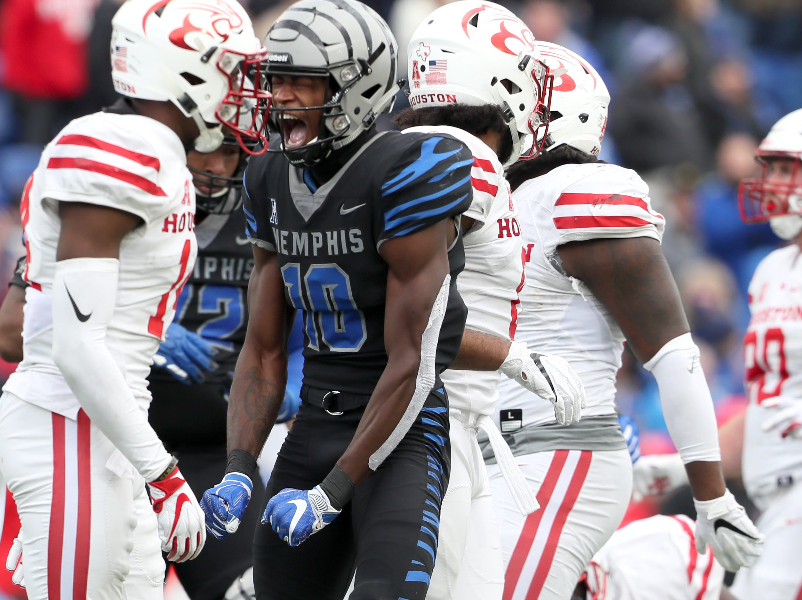Memphis' Damonte Coxie celebrates a first down against the Houston Cougars as the Tigers win the AAC West title 52-31 at the Liberty Bowl on Friday, Nov. 23, 2018.