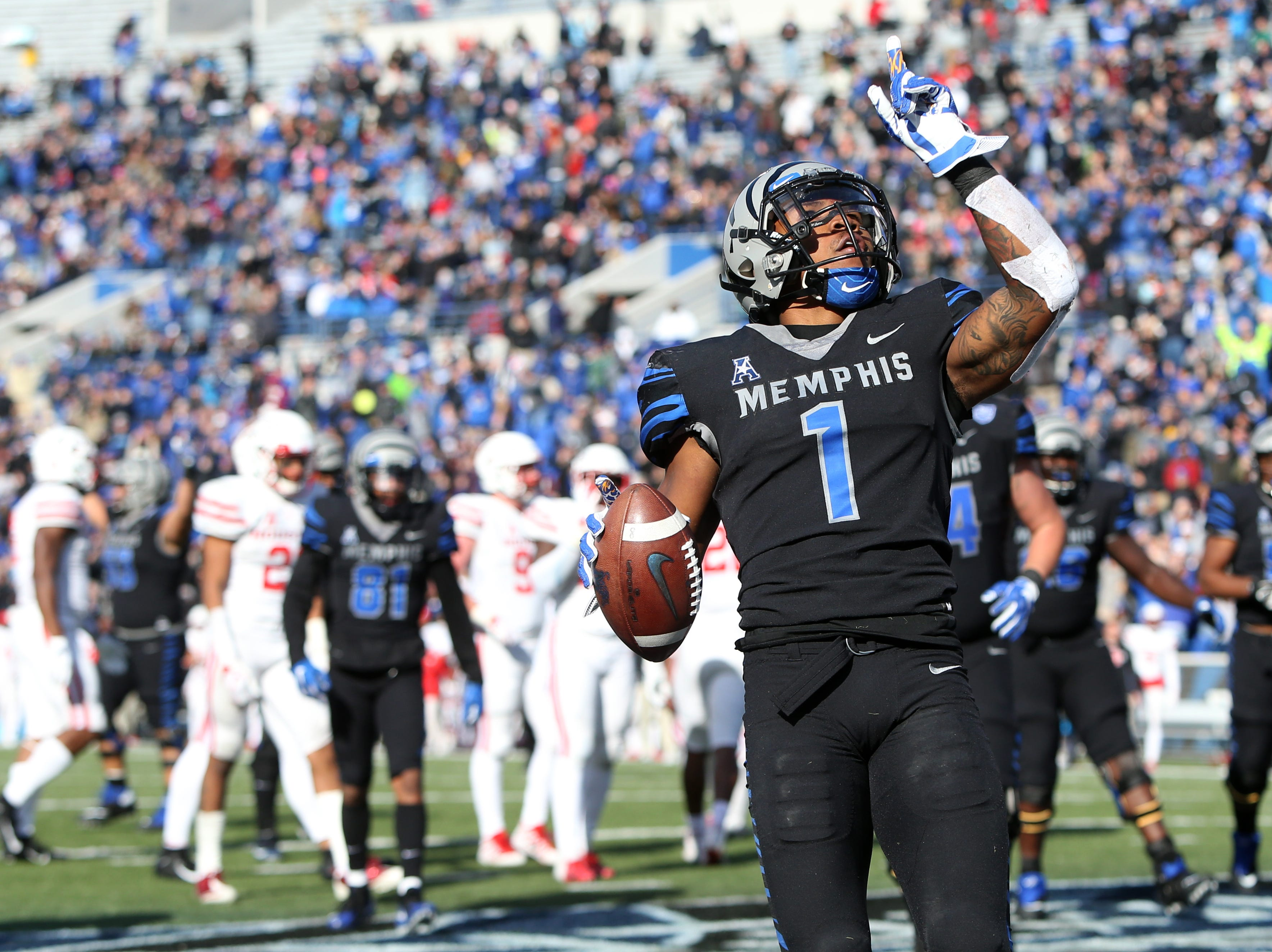 Memphis' Tony Pollard celebrates his touchdown against the Houston Cougars as the Tigers win the AAC West title 52-31 at the Liberty Bowl on Friday, Nov. 23, 2018.