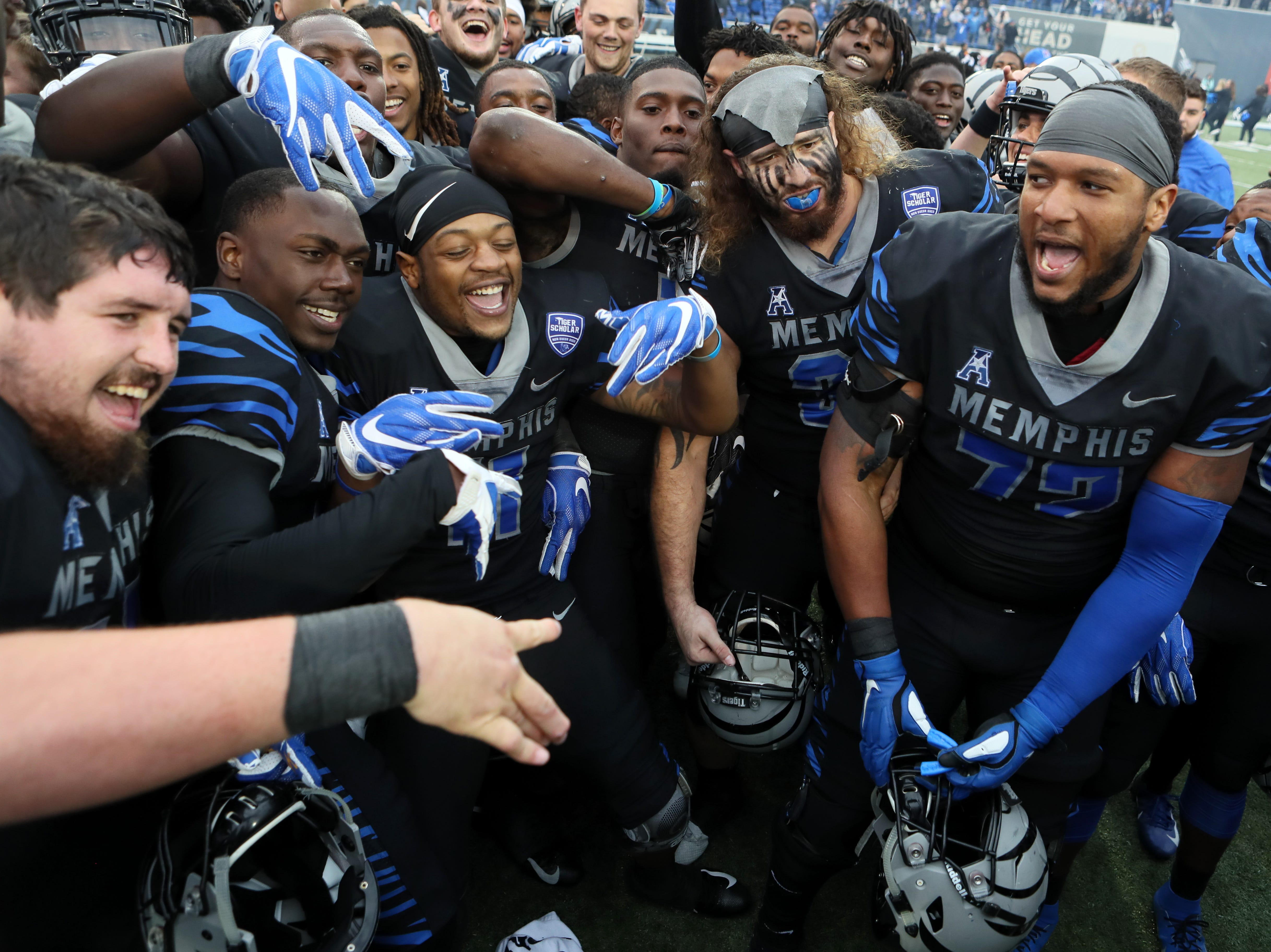 Memphis players celebrate as the Tigers win the AAC West title 52-31 against Houston at the Liberty Bowl on Friday, Nov. 23, 2018.