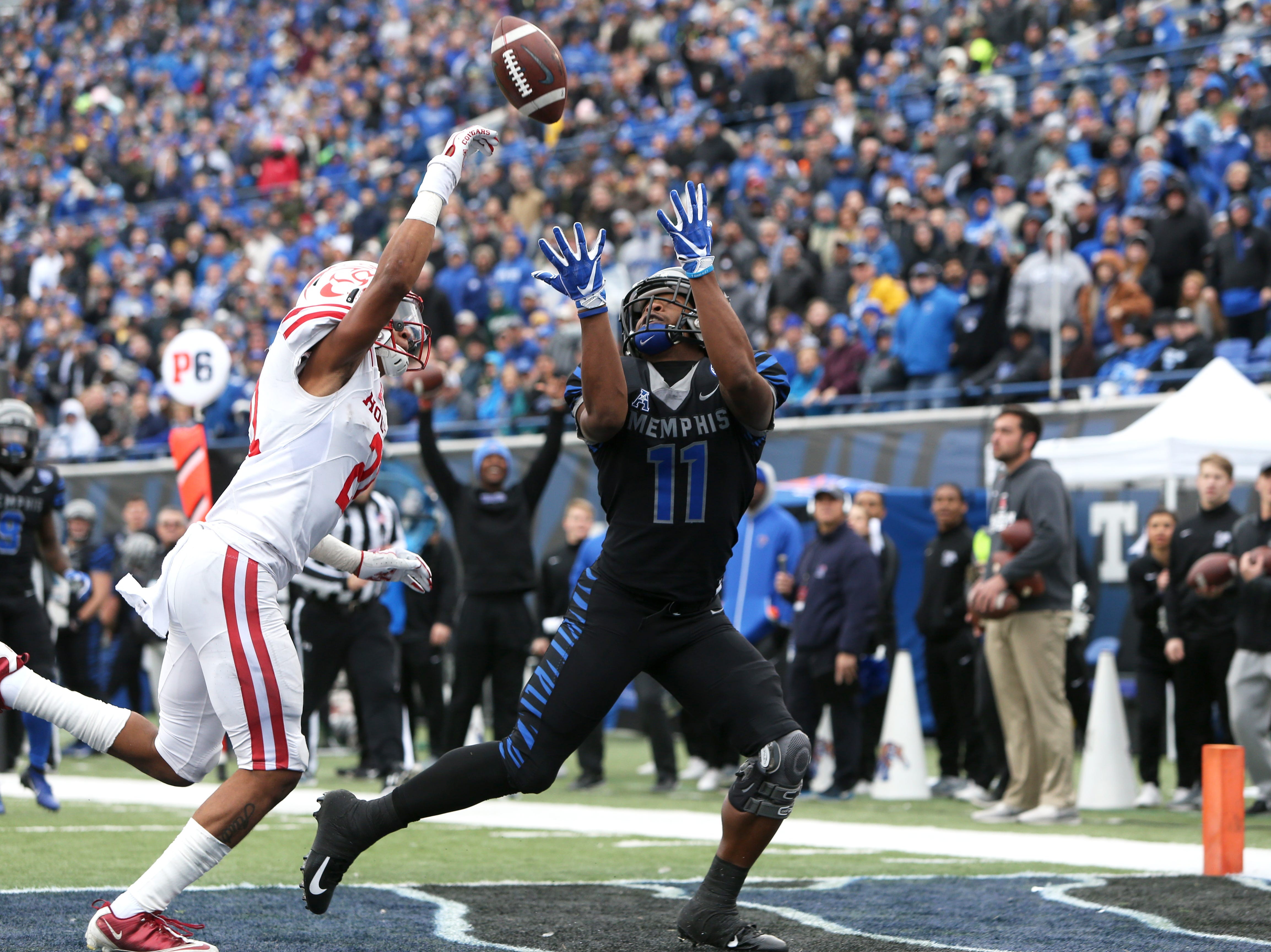 Memphis Tigers' Sam Craft tries to catch a touchdown pass, coming up just short in the endzone against Houston Cougars defender Gleson Sprewell at the Liberty Bowl Memorial Stadium on Friday, Nov. 23, 2018.