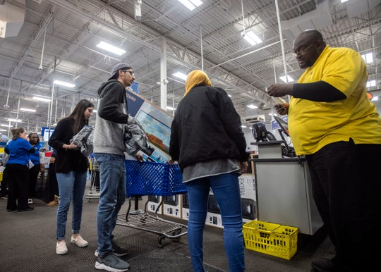 People line up to check out as they shop for Black Friday sales at a Best Buy store on Thanksgiving Day 2018 in Memphis.