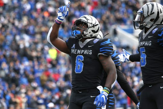 Memphis Tigers' Patrick Taylor Jr. celebrates his touchdown run against the Houston Cougars at the Liberty Bowl Memorial Stadium on Friday, Nov. 23, 2018.