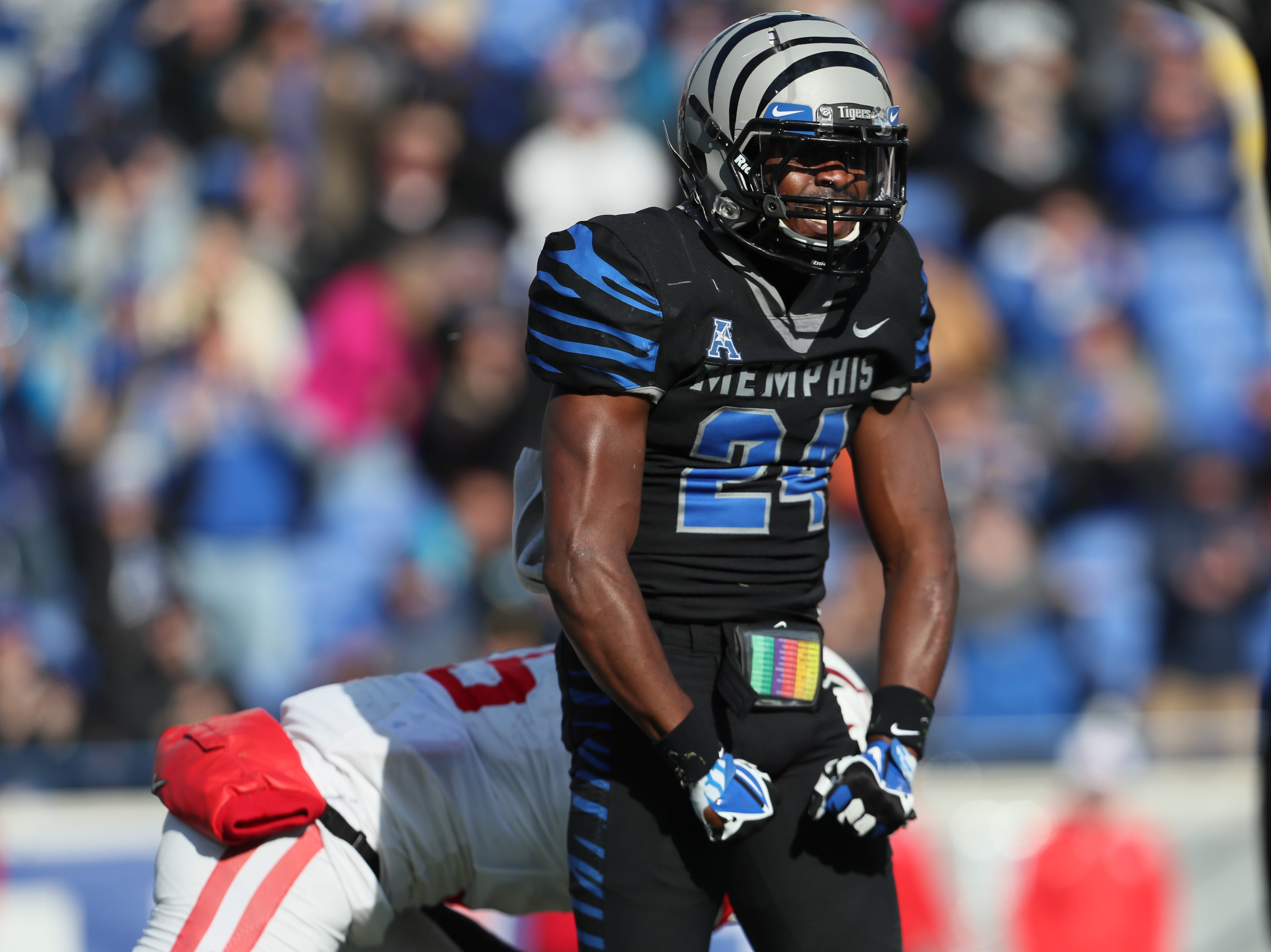 Memphis' Tito Windham celebrates a tackle against the Houston Cougars as the Tigers win the AAC West title 52-31 at the Liberty Bowl on Friday, Nov. 23, 2018.
