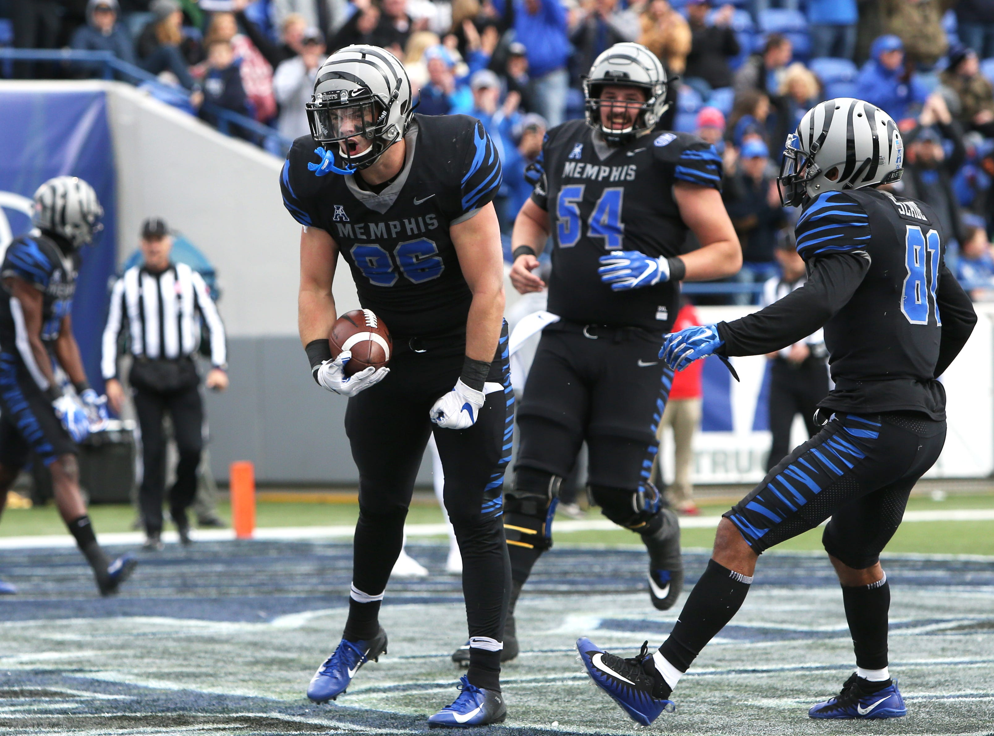 Memphis' Joey Magnifico celebrates his touchdown reception against Houston Cougars as the Tigers win the AAC West title 52-31 at the Liberty Bowl on Friday, Nov. 23, 2018.