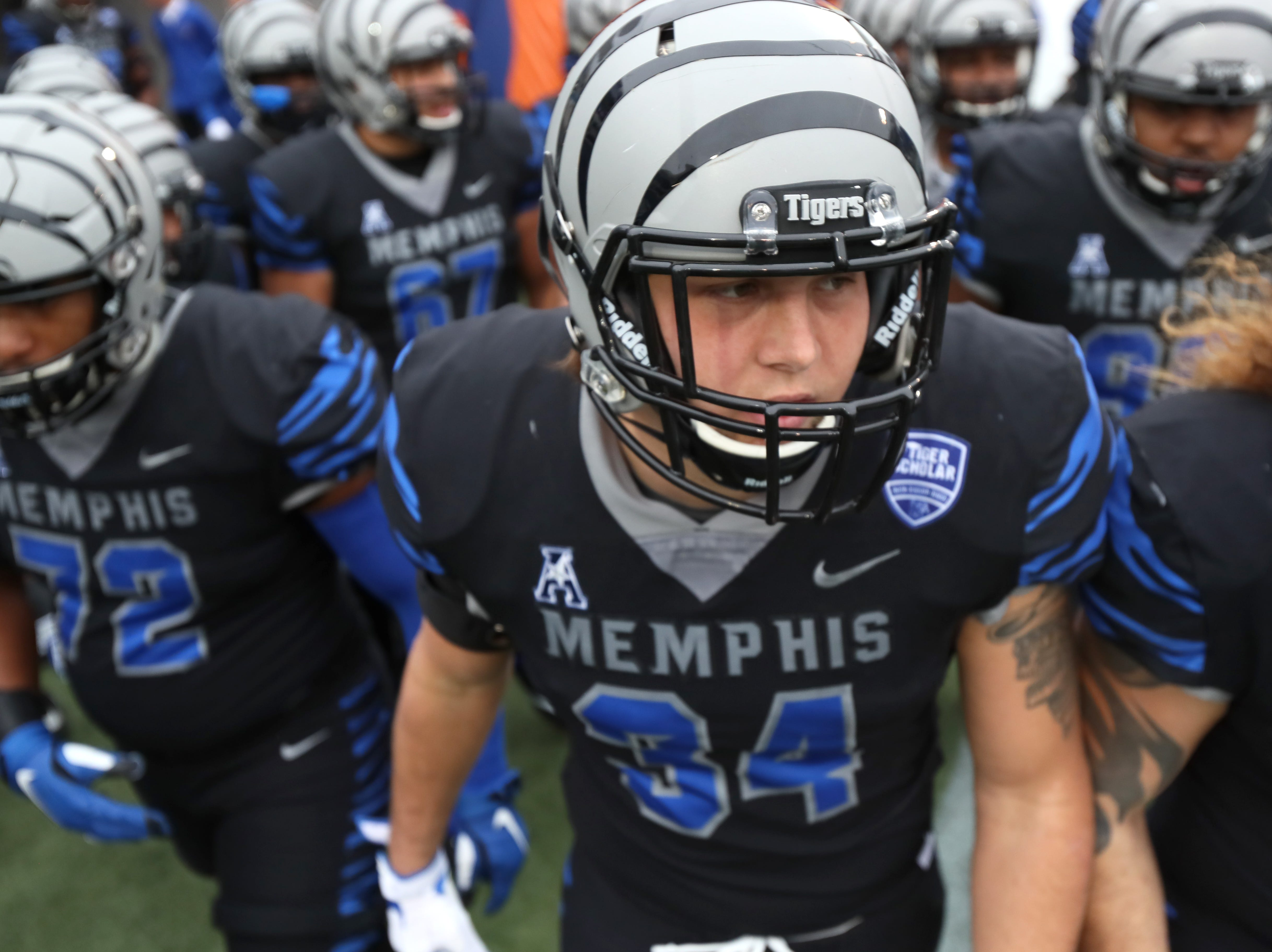 Memphis Tigers' Jackson Dillon heads out to the field to warm up before their game against the Houston Cougars at the Liberty Bowl on Friday, Nov. 23, 2018.