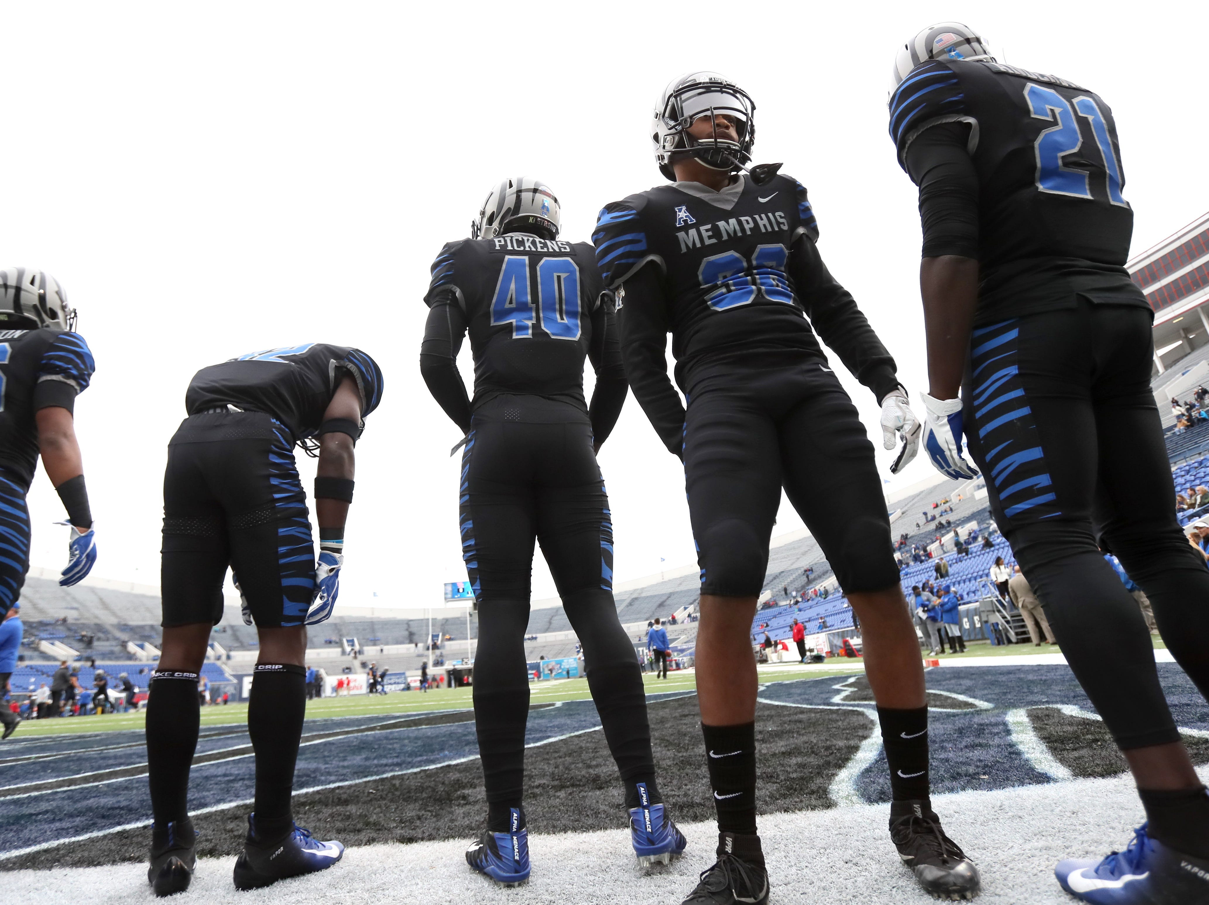 Memphis Tigers players warms up before their game against the Houston Cougars at the Liberty Bowl on Friday, Nov. 23, 2018.