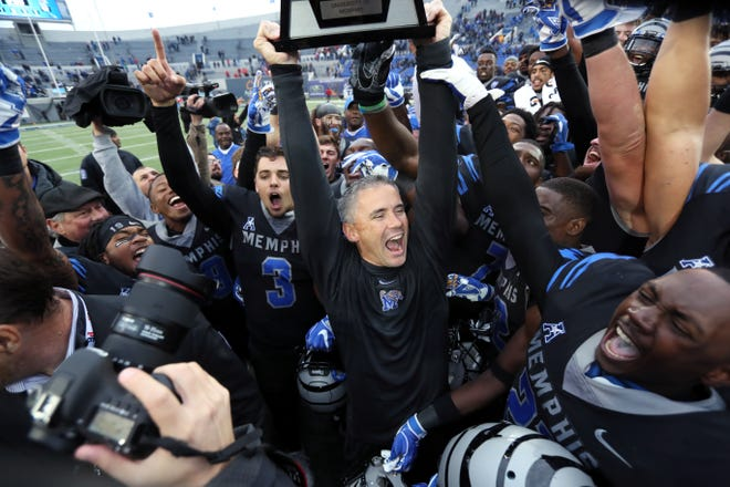 Memphis coach Mike Norvell celebrates with his players after they defeated Houston to win the AAC West title 52-31 on Nov. 23 at the Liberty Bowl.