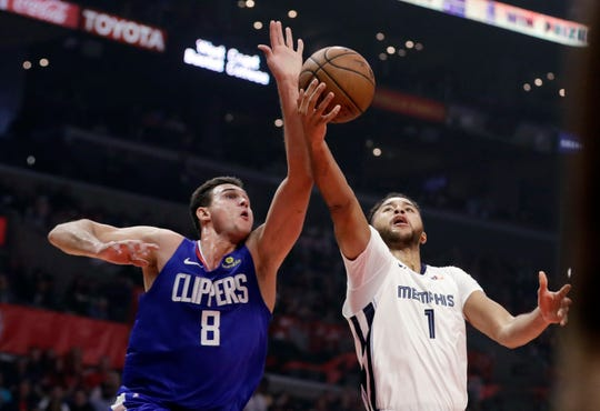 Los Angeles Clippers' Danilo Gallinari (8) blocks a shot from Memphis Grizzlies' Kyle Anderson (1) during the first half of an NBA basketball game Friday, Nov. 23, 2018, in Los Angeles. (AP Photo/Marcio Jose Sanchez)
