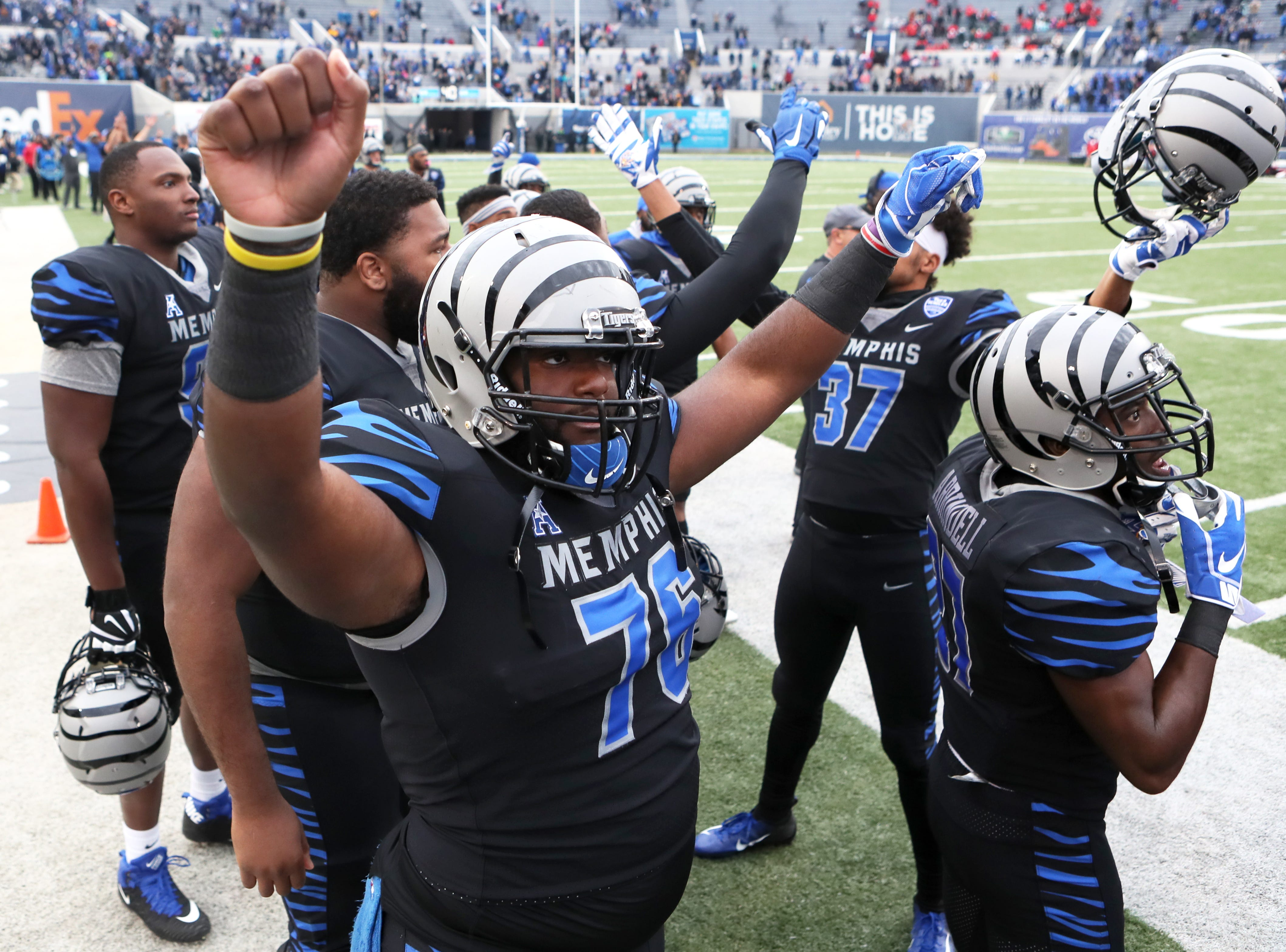 Memphis players celebrate their win against the Houston Cougars as the Tigers take the AAC West title 52-31 at the Liberty Bowl on Friday, Nov. 23, 2018.