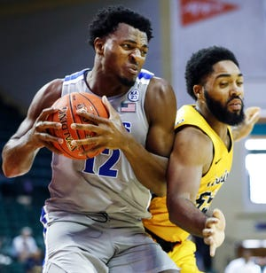 Memphis forward Victor Enoh (left) grabs a rebound away from Canisius defender Kejuan Johnson-Alls (right) during second day action in the Advocate Invitational in Orlando Friday, November 23, 2018.
