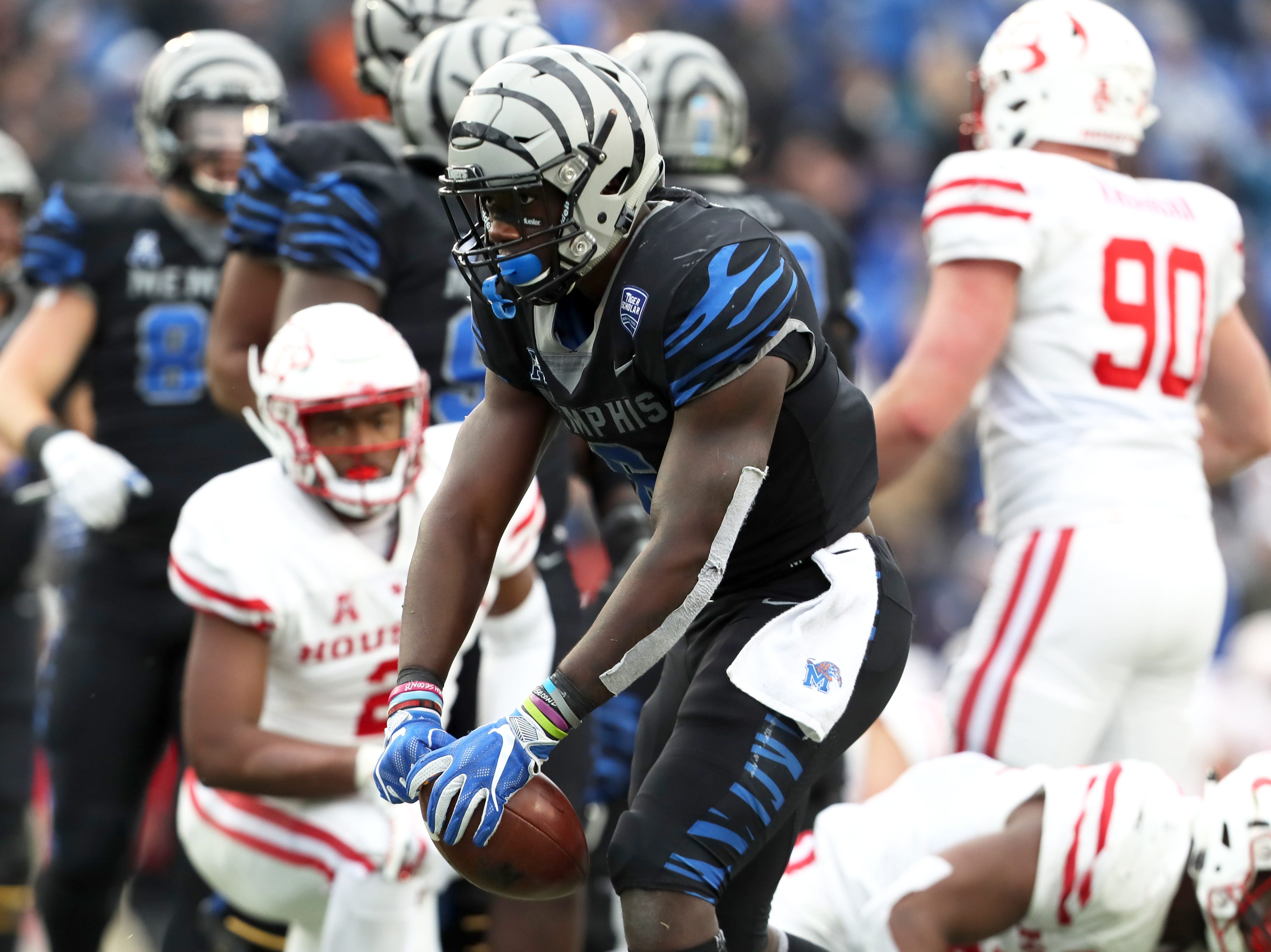 Memphis' Patrick Taylor Jr. celebrates a first down against the Houston Cougars as the Tigers win the AAC West title 52-31 at the Liberty Bowl on Friday, Nov. 23, 2018.