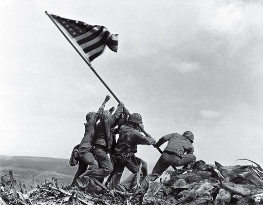"""Flag Raising on Mt. Suribachi"" by Joe Rosenthal."