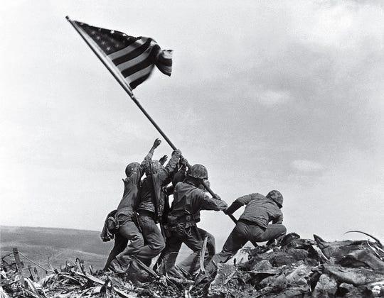 """Flag Raising on Mt. Suribachi"" by Joe Rosenthal."