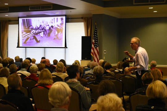 "Louis Masur talks about ""The Soiling of Old Glory,"" a photo on which he wrote a book. About 300 attended a presentation called ""Understanding America through Five Remarkable Photographs"" in the One Day University session Nov. 16 at New Hope Event Center."