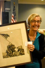 """Flag Raising on Mt. Suribachi,"" by Joe Rosenthal, became the most iconic photo of World War II, and Dianne Maybrerry-Hatt brought a signed print to the talk. She was among the attendees to ""Understanding America through Five Remarkable Photographs"" in the One Day University session Nov. 16 at New Hope Event Center."