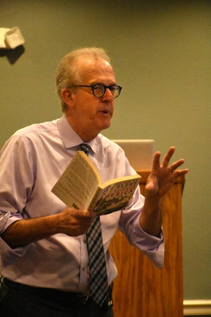 """Louis Masur quotes from the book he wrote about """"The Soiling of Old Glory."""" during a presentation called """"Understanding America through Five Remarkable Photographs"""" in the One Day University session Nov. 16 at New Hope Event Center."""