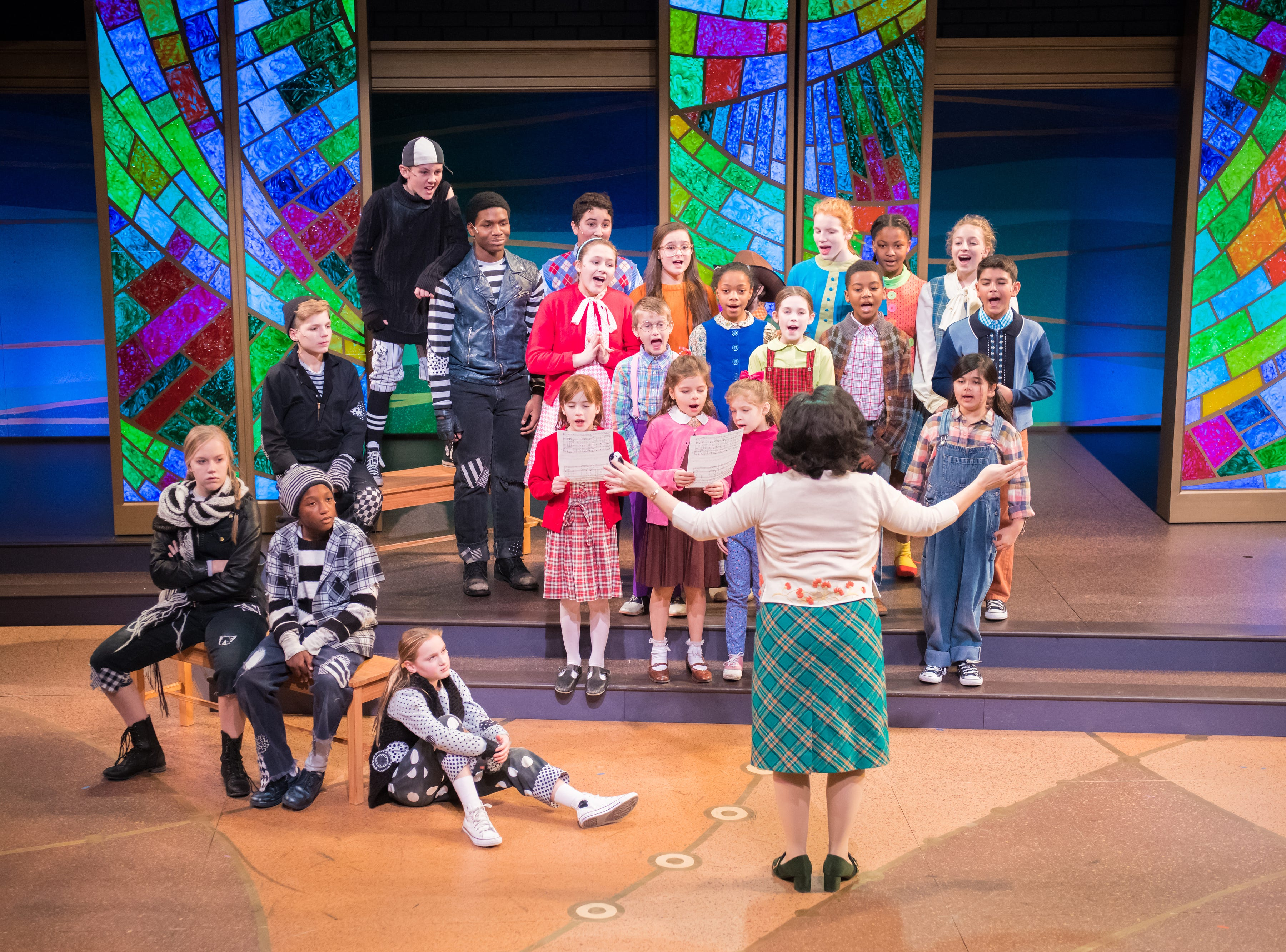 """Karen Estrada conducts the Jolly cast in """"The Best Christmas Pageant Ever: The Musical,"""" performed by First Stage."""