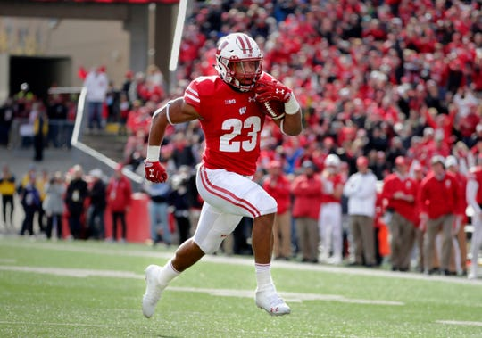 Wisconsin Badgers running back Jonathan Taylor (23) breaks away for a touchdown in the second half  during Wisconsin's 31-17 win over Rutgers during the Big Ten football game against Rutgers at Camp Randall  in Madison, Wisconsin  Saturday, November 3, 2018. - Photo by Rick Wood / Milwaukee Journal. RICK WOOD/MILWAUKEE JOURNAL SENTINEL