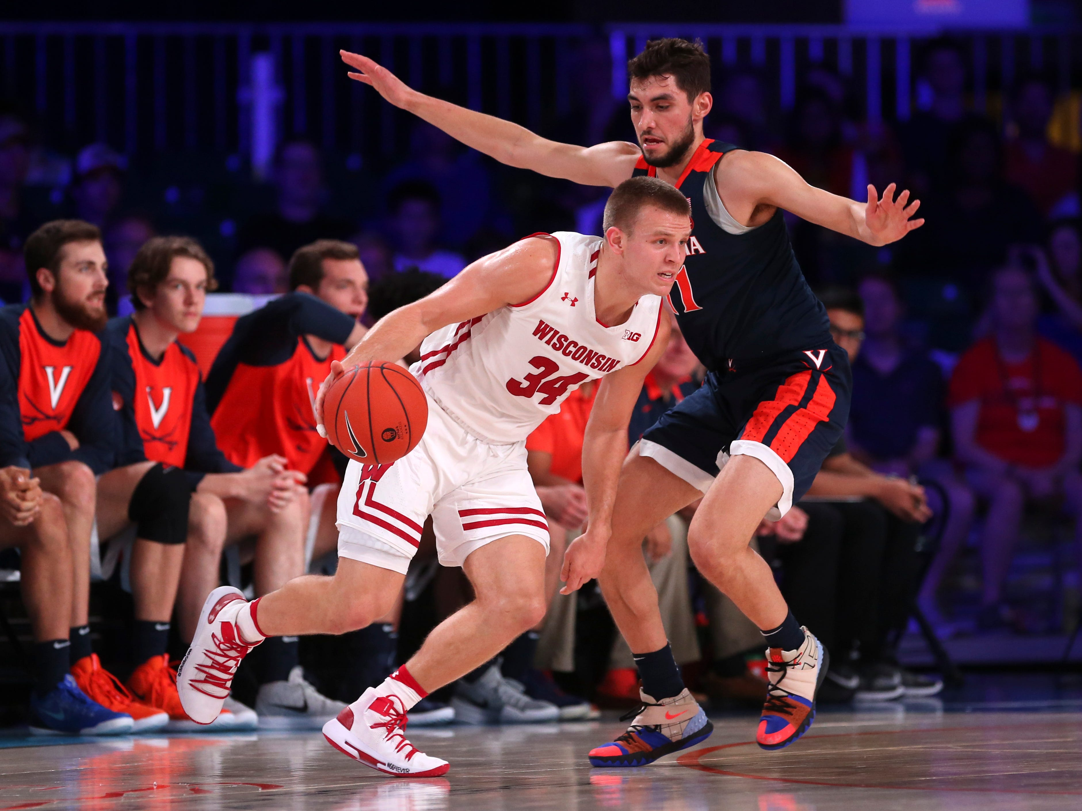 Badgers guard Brad Davison tries to get around Virginia's Ty Jerome.