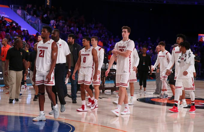 Wisconsin leaves the court after dropping the Battle 4 Atlantis title game to Virginia.