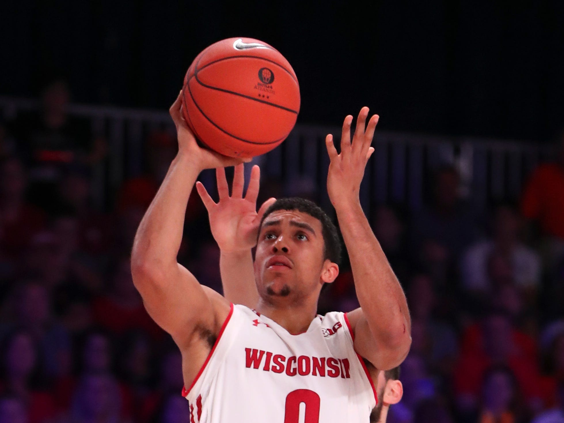 Badgers guard D'Mitrik Trice and his teammates couldn't solve Virginia's defense on Friday.