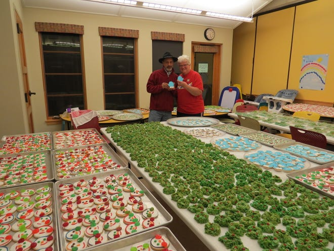 Nickolas Ray and Lisa Morris stand with some of the over 5,000 cookies sold at last year's sale.